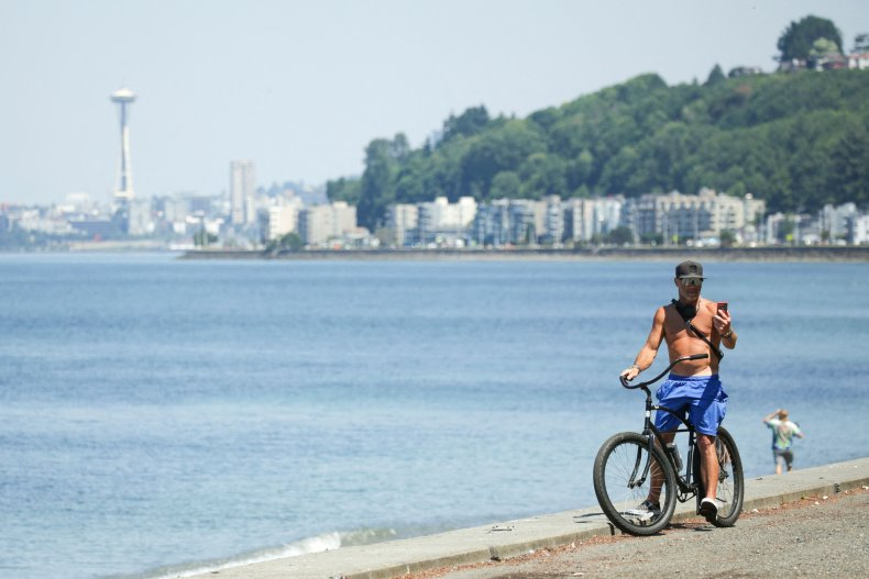 A topless bike-rider in Seattle.