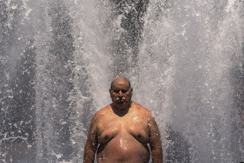 Man cools off at a fountain, Portland.