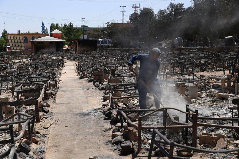 Aftermath of Taliban burning a market.