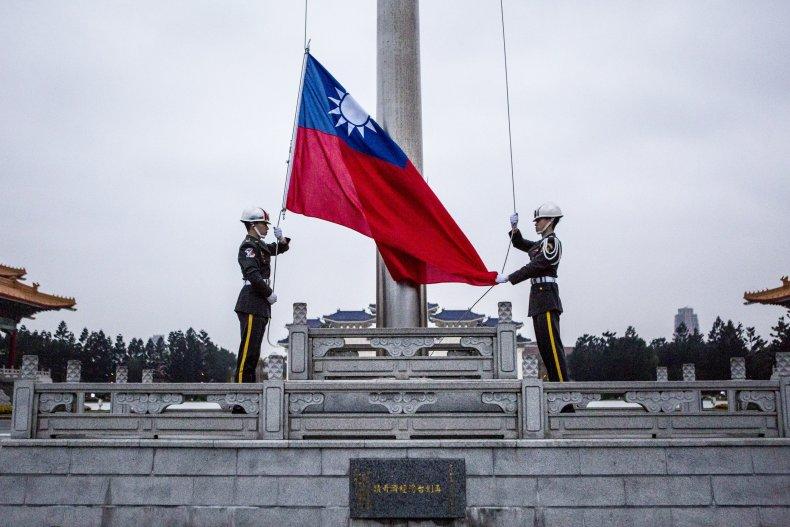 Honor guards raise the Taiwan flag