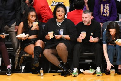 Lizzo attends a Los Angeles Lakers game