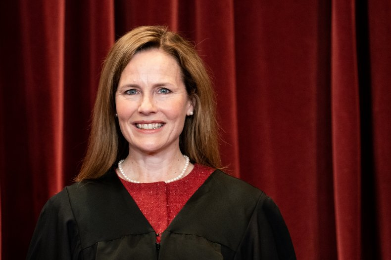 Amy Coney Barrett Stands During a Photo