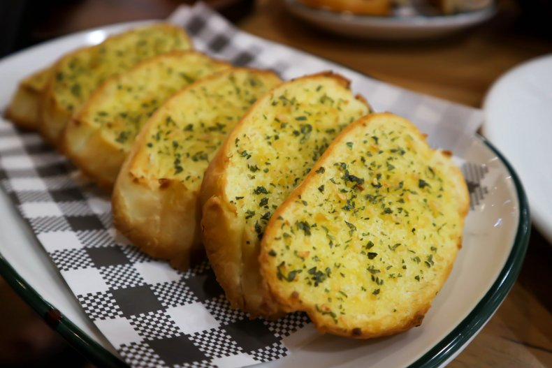 A plate of garlic bread slices.