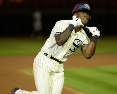Tim Anderson reacts after hitting home run