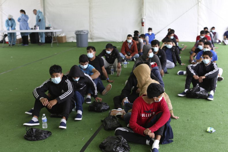 Migrants wait for COVID test