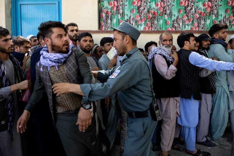 Afghans wait outside the passport office, Kabul.