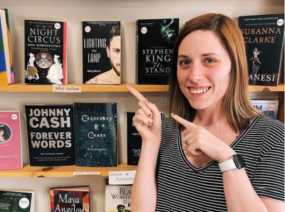 Abby Burch posing with her book.