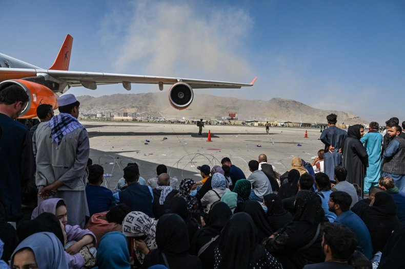 Afghans Wait to Leave Kabul Airport