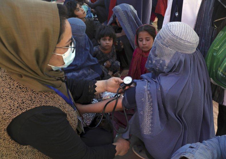 Afghan Woman Has Blood Pressure Taken