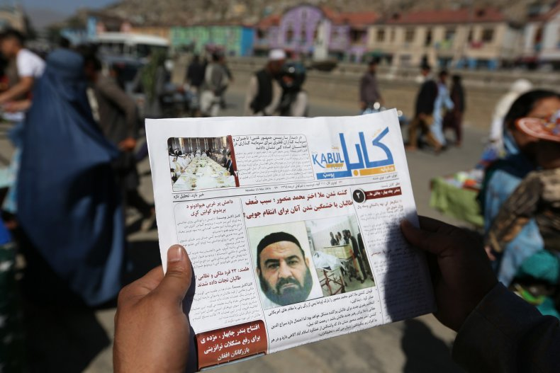 An Afghan Man Reads a Newspaper