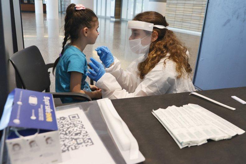 An Israeli child undergoes an antigen test