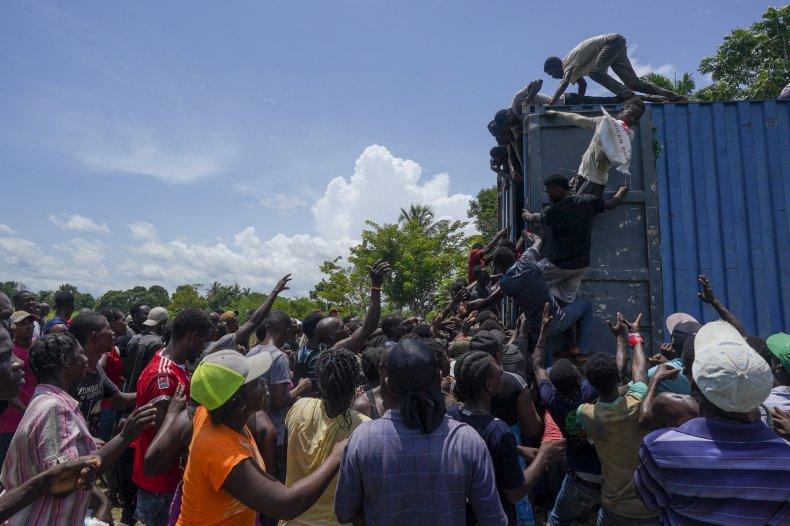 Haitians Loot Relief Truck