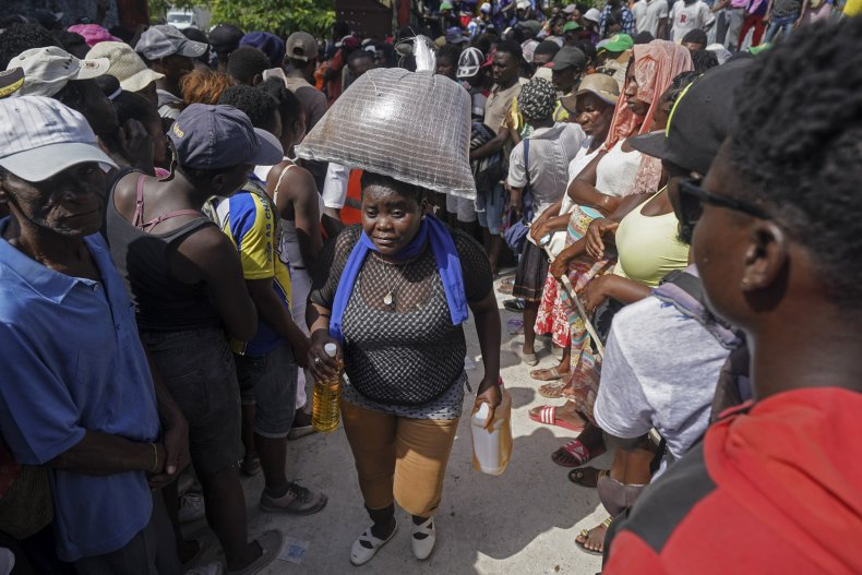 Haitians Line Up for Aid After Earthquake