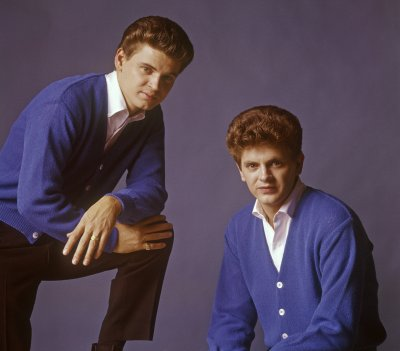 The Everly Brothers posing together.