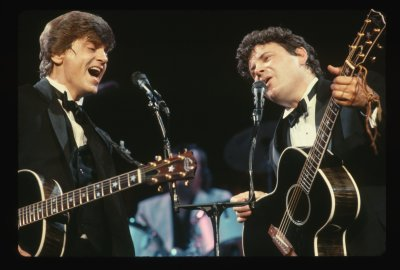 The Everly Brothers performing on stage.