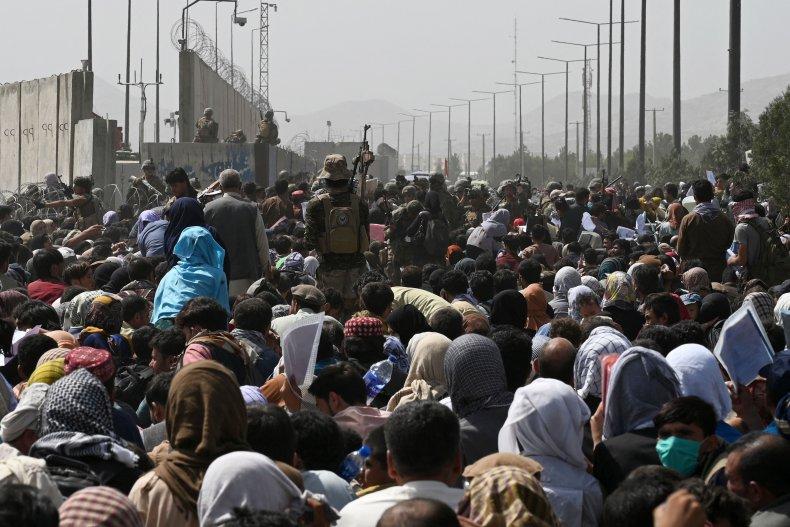 Afghans gather on a roadside