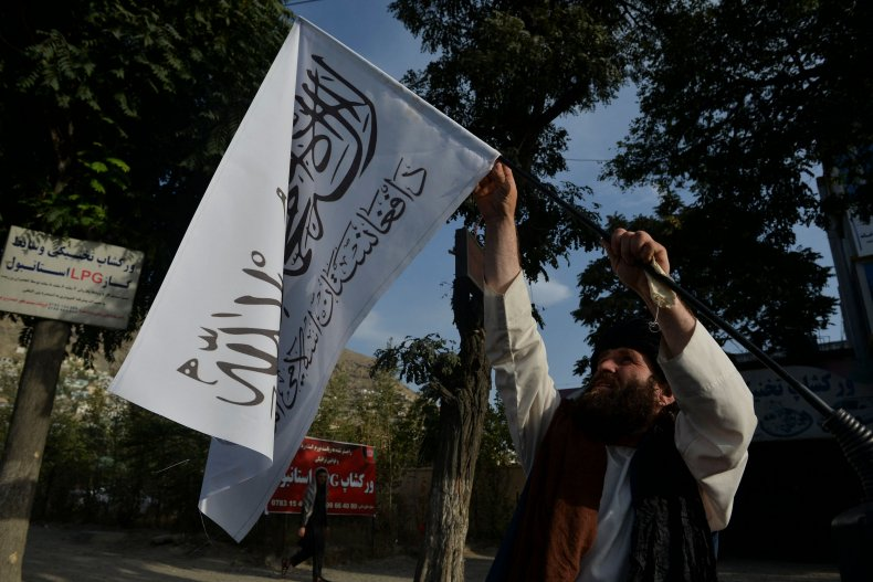 Man with Taliban flags in Kabul, Afghanistan