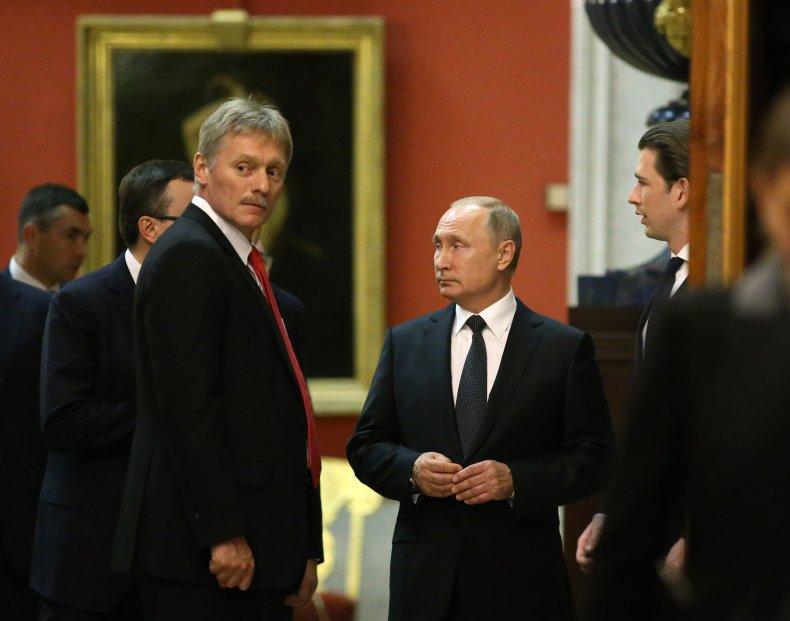 Kremlin Spokesman Dmitry Peskov and Vladimir Putin