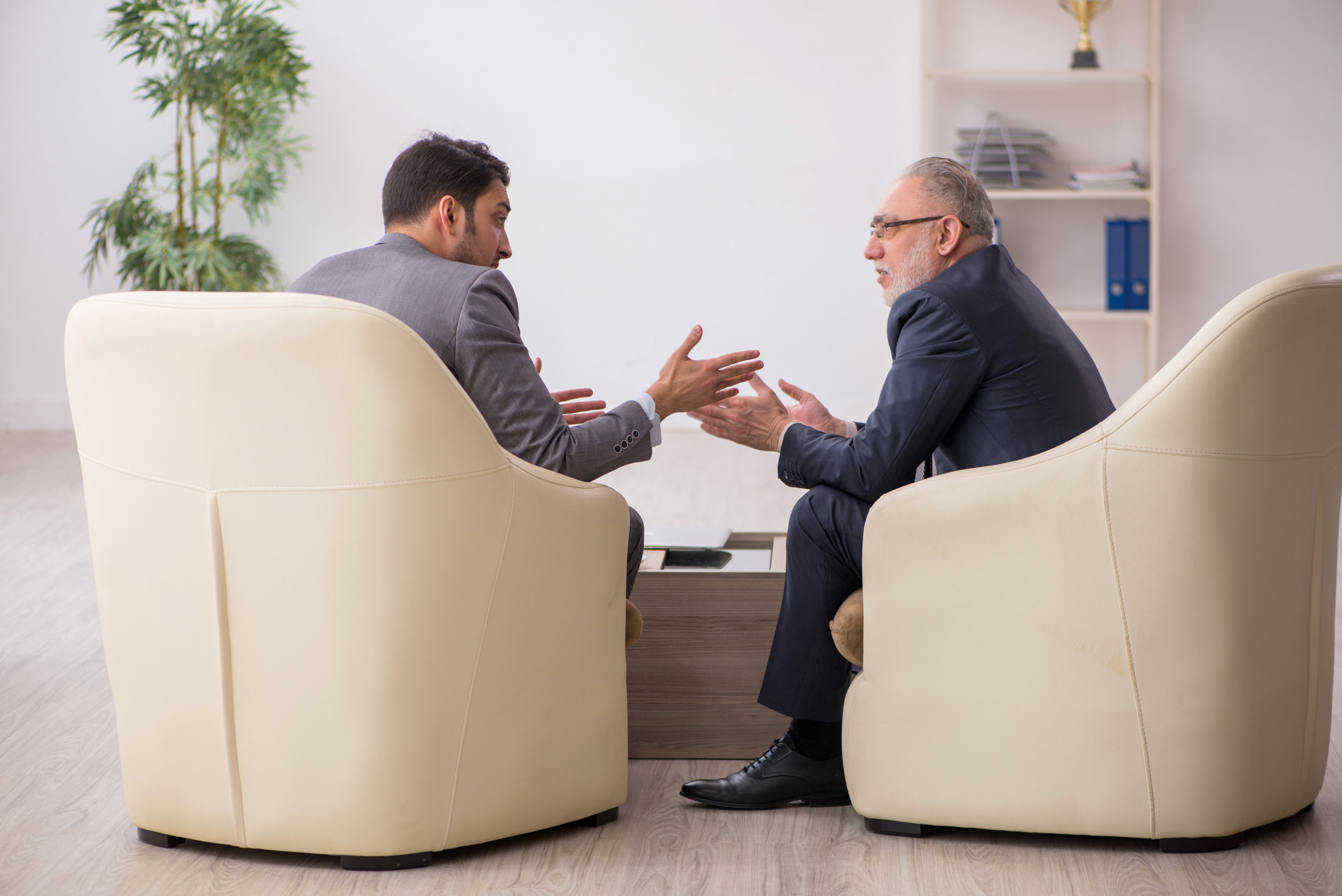 Two businessmen discussing project at workplace