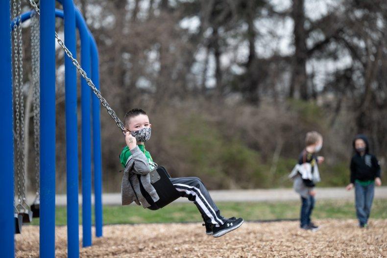 A child uses a swingset