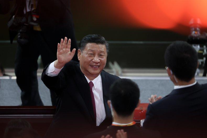 Chinese President Xi Jinping waves as he