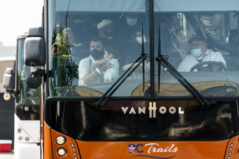 A bus arrives at a processing center