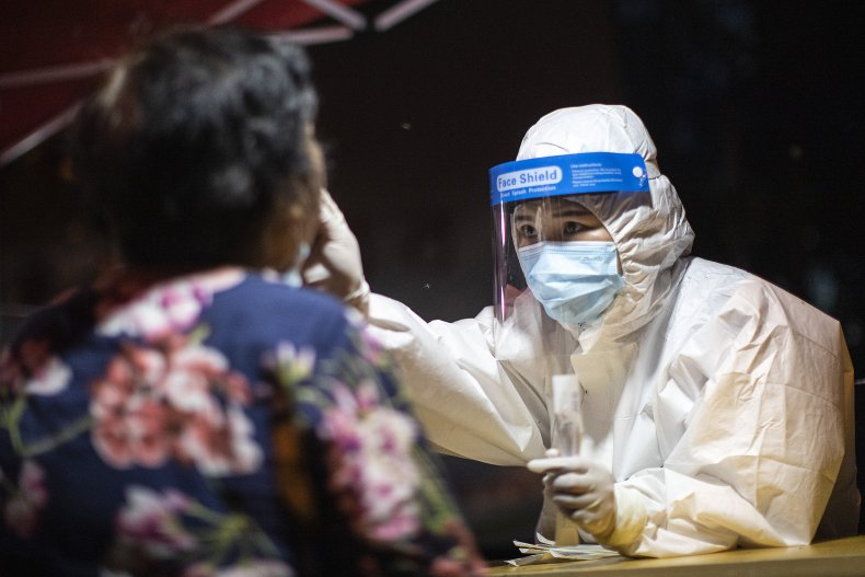 Wuhan Medical Worker Takes COVID Swab