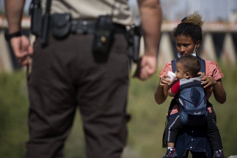 Migrant Child Holding a Baby