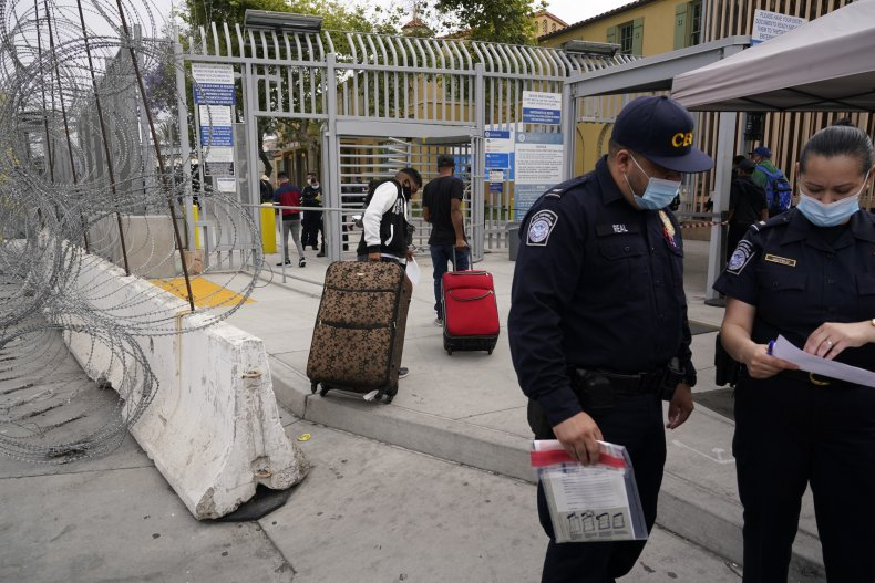 Asylum Seekers With Suitcases