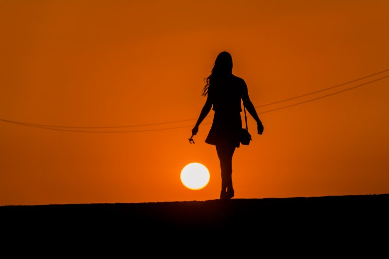 A silhouette of a girl