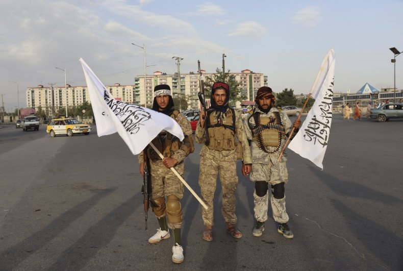 Taliban Fighters Hold Taliban Flags