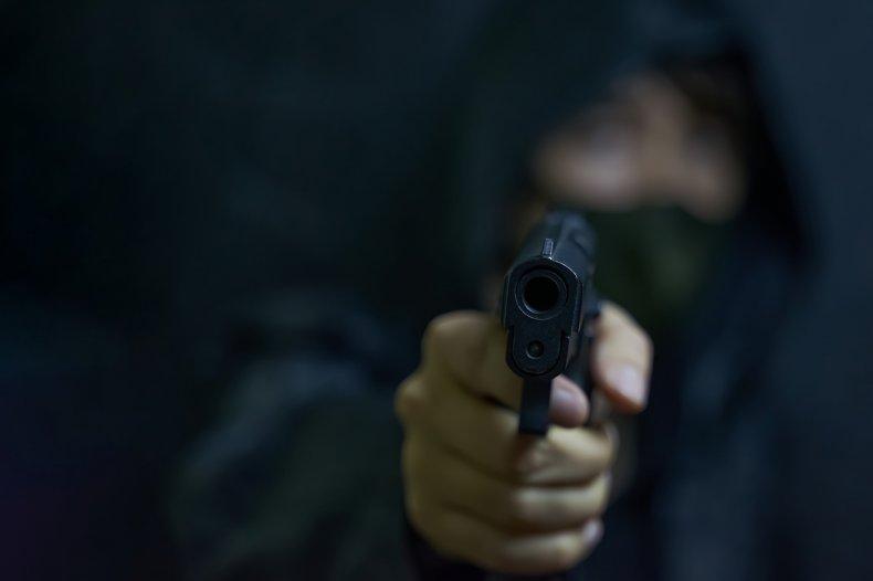 Stock photo of a masked gunman