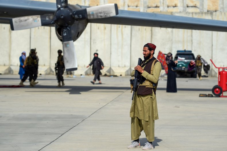 Taliban fighters stand guard at Kabul's airport
