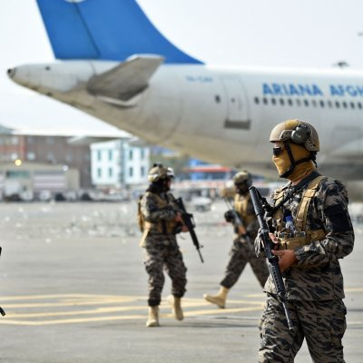Taliban fighters arrive at Kabuls airport