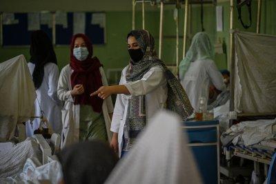 Nurses treat patients at hospital in Kabul