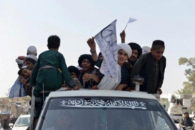 Youth in Cars at Taliban Parade