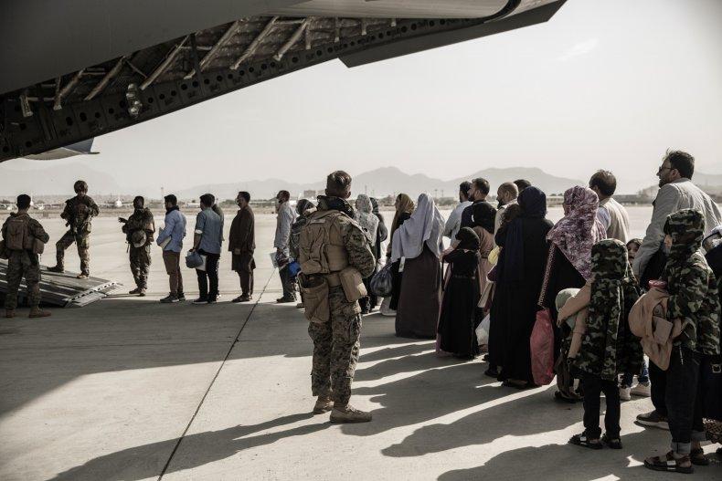 Afghan Evacuees Wait to Board Plane