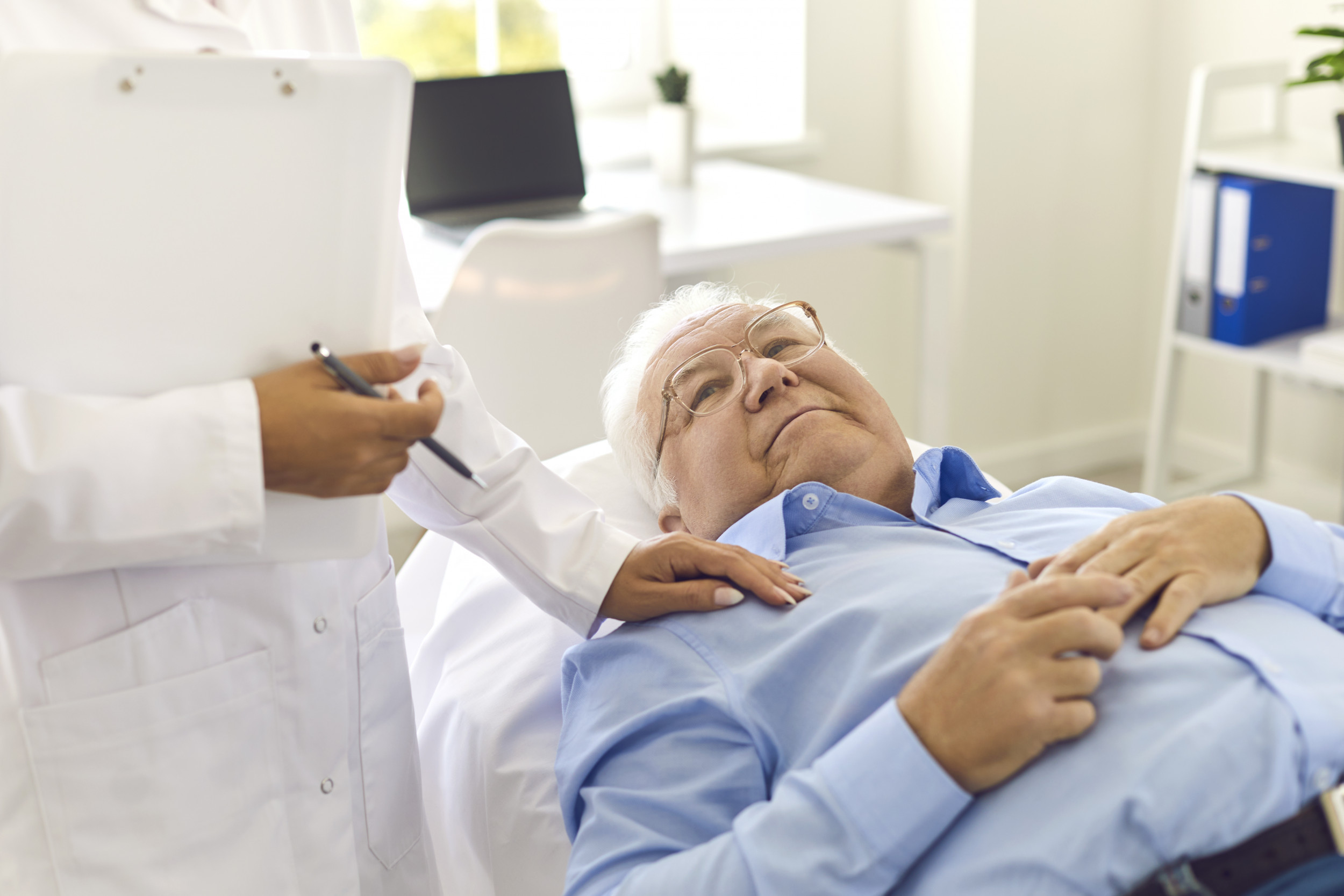 older person getting a checkup