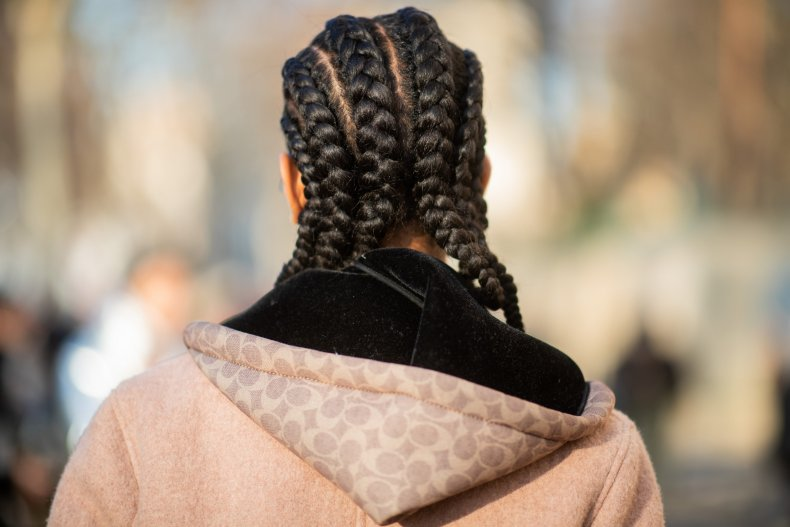 A model is seen with cornrows