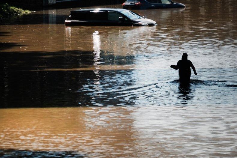 man walking through floodwater in new york