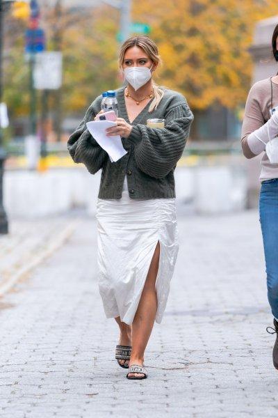 Hilary Duff wears a white dress