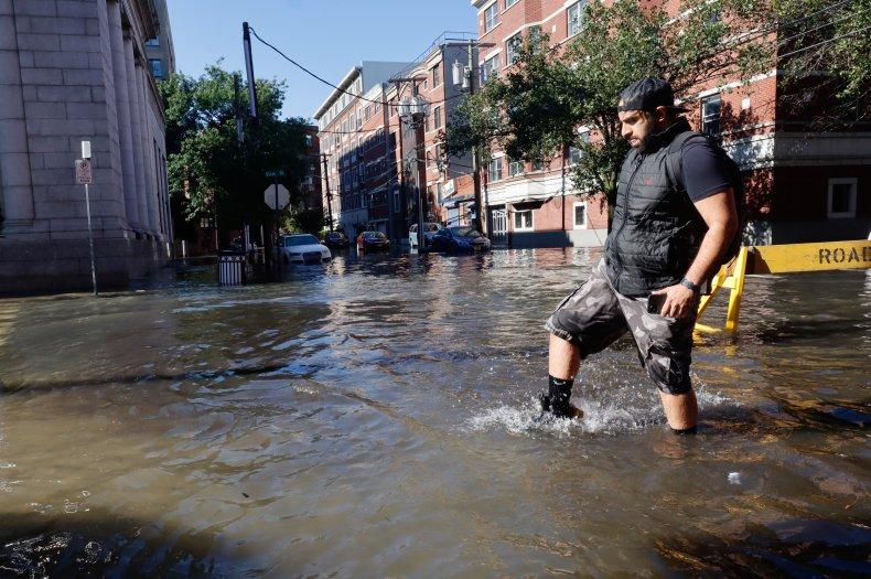 A Man Walks Through Flooded New York