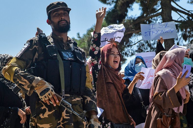 Taliban fighter and protester women in Kabul
