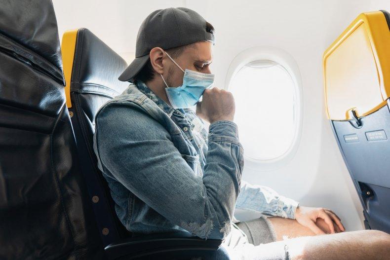 Man coughing on plane