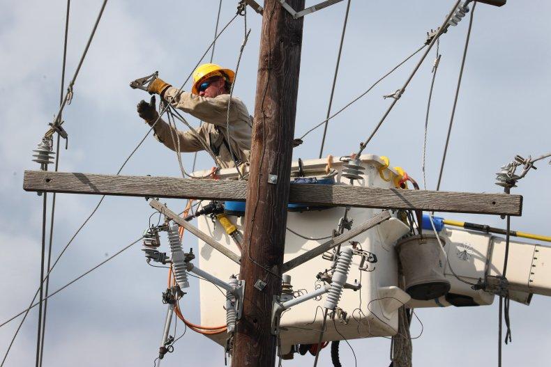 Workers Repair Power Lines After Ida