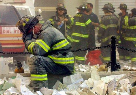 9/11 firefighter praying