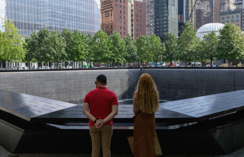 A couple stands before the 9/11 Memorial