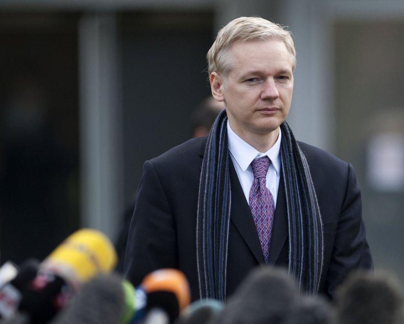WikiLeaks founder Julian Assange approaches microphones