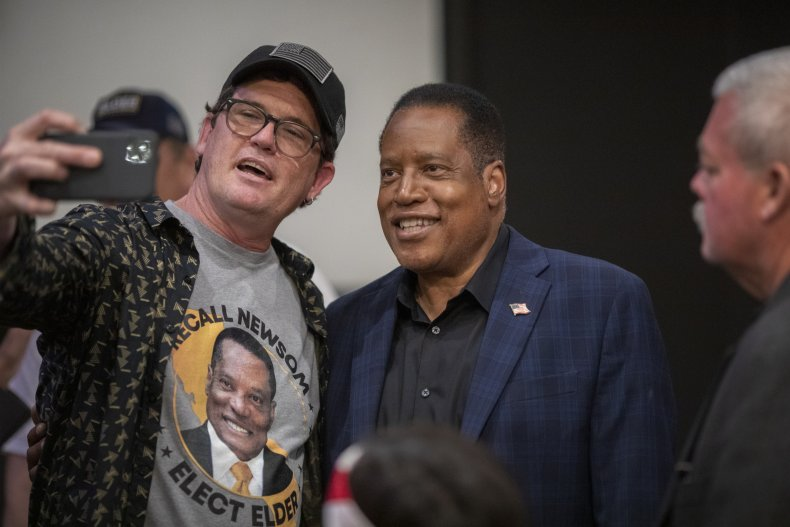 Larry Elder with a campaign supporter.