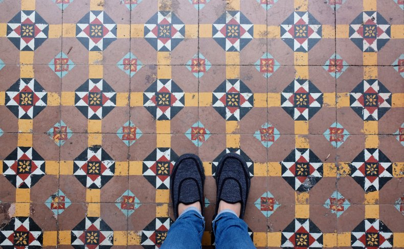 File photo of feet on tiled floor.